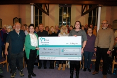 Presenting the donation from money raised at the Christmas concert to The Beacon Centre